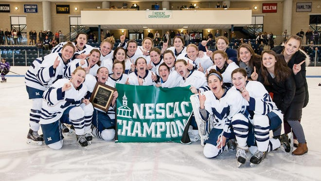 The Middlebury women's ice hockey team celebrates its eighth NESCAC championship on Sunday afternoon after beating Amherst 5-4 in overtime.