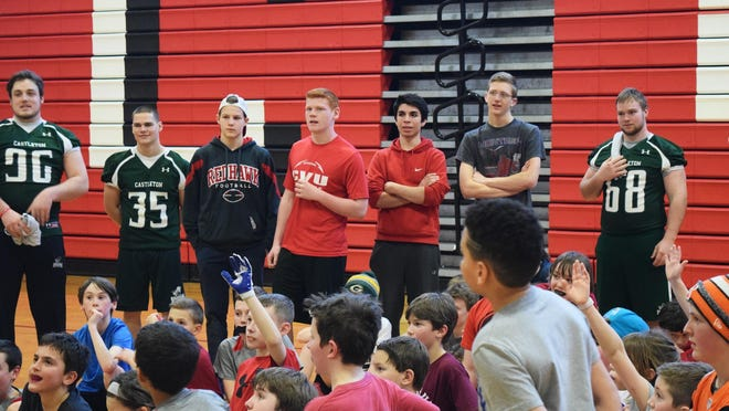 Champlain Valley Union and Castleton University players talk football at the March 6 Flag Football event.