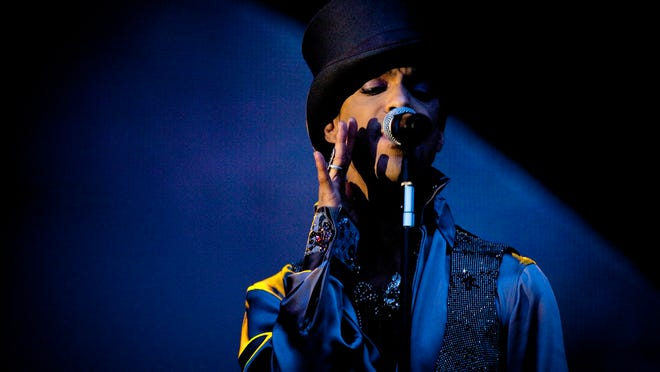 FILE - In this Aug. 6 2011 file photo, American singer and songwriter Prince performs on the Isle of Amager in Copenhagen, Denmark. (AP Photo/Polfoto/Jakob Joergensen, File)
