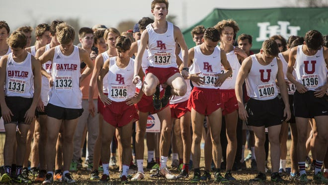 Carter Cheeseman of Brentwood Academy warms up before his race during the 2016 TSSAA State Cross Country Championship at Percy Warner Park.