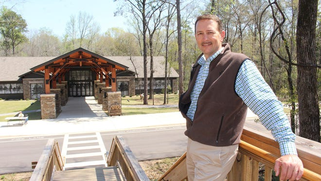 Alabama Wildlife Federation Executive Director Tim Gothard stands above the Nature Center site that attracts thousands of tourists each year.