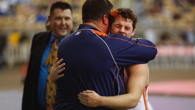 Matthew Sells of Blackman hugs his father, Matt Sells, after winning the 160-pound weight class at the Class AAA state wrestling championships in Franklin.