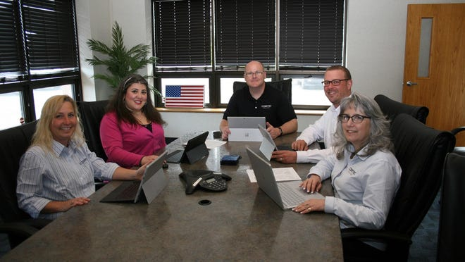 ComTec Solutions staff includes Kathryn Weston, left, manager, Enterprise Systems; Kristine Caronna, office manager; Rob Moyer, president; Jason Stott, manager, Information Technology; Mary Cronin, vice president.