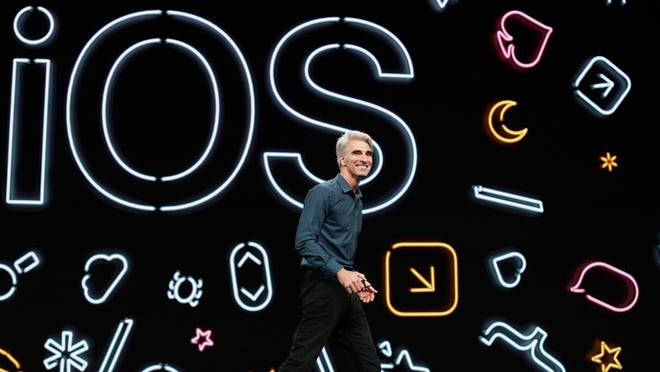 Craig Federighi, Apple's senior vice president for software engineering, unveils iOS 13 for the iPhone at its developers conference in June.