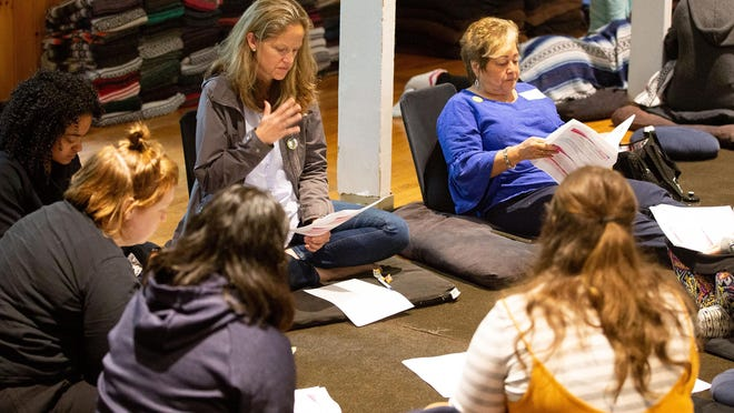 Megan Bambino, center left, and Marie Vega-Byrne, upper center right, board members of Fearless! Hudson Valley Inc., formerly named Safe Homes of Orange County, join a group discussion during a nonprofit retreat last spring at the Omega Institute for Holistic Studies in Rhinebeck.