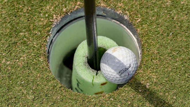 A small piece of a foam noodle is placed around the flagstick at the 18th hole so that golfers won't put their hands in the cup and potentially spread the coronavirus to another person at the Abacoa Golf Club in Jupiter on April 28, 2020.