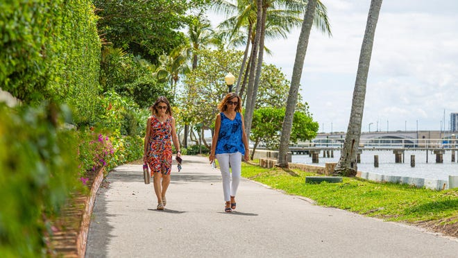 Donna Sprunger and Lucy Cruz of Wellington, take a walk on the Lake Trail on Tuesday. The town put new regulations in place to limit the amount of traffic on the Lake Trail due to  COVID-19.