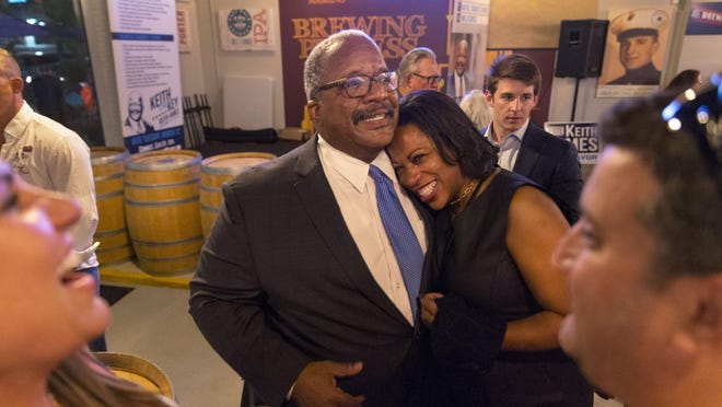 Newly elected Mayor Keith James celebrating with his wife Lorna James at the West Palm Brewery & Wine Vault on March 12.