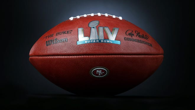 An official ball for the NFL Super Bowl LIV football game with the San Francisco 49ers logo that was made at the Wilson Sporting Goods Co. in Ada, Ohio, Monday, Jan. 20, 2020. The Kansas City Chiefs will play the San Francisco 49ers in the Super Bowl LIV on Feb. 2, in Miami.