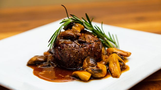 Cucina Moderna's barrel-cut filet mignon is served in a wild mushroom demi with caramelized shallot confit.