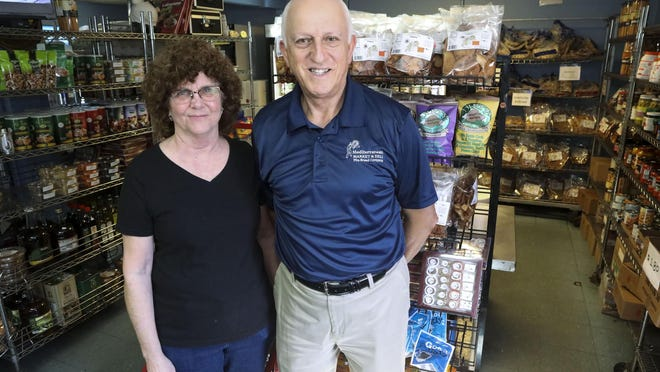 The Mediterranean Market and Deli's co-owners are Marie and Adib Salloum, who are shown in their retail shop.