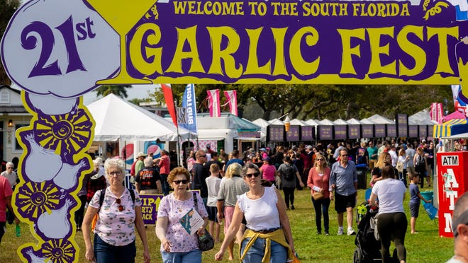 Visitors enjoy the food tents during the South Florida Garlic Fest Saturday inside John Prince Park in Lake Worth Beach on Feb. 8, 2020.