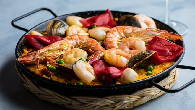 Paella Valenciana is served at Tapeo restaurant in downtown West Palm Beach. The Spanish-style, saffron-scented rice dish is rich with shrimp, clams, mussels, squid, scallops, chorizo and chicken.