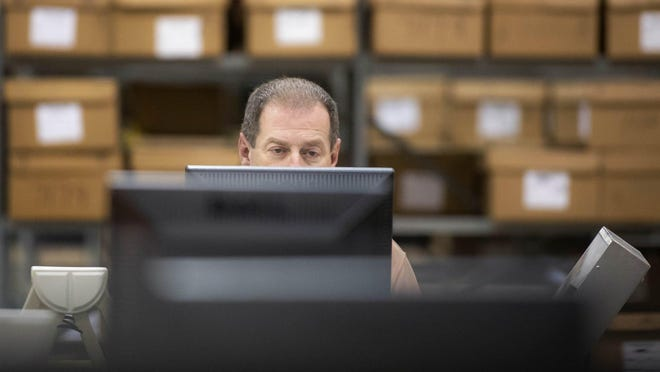 Information Technology Manager Jeff Darter works at a tabulation machine during a recount of the House District 89 race between Republican candidate Mike Caruso and Democratic candidate Jim Bonfiglio at the Supervisor of Elections Service Center in Riviera Beach on Nov. 18, 2018.
