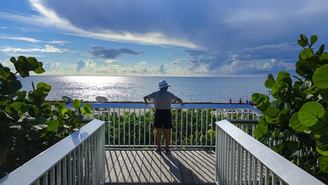 A beachgoer on July 30 looks out at the ocean at Oceanfront Park.
