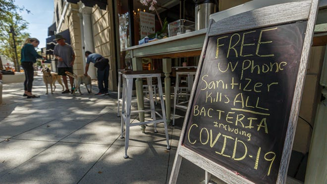 Clematis Street restaurants in downtown West Palm Beach had many empty sidewalk tables and few patrons within their establishments on Monday, following the state of emergency that was declared in Palm Beach County.