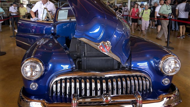 Don Gasiunas of Toronto shines up his 1947 Super 8 Custom Convertible to auction at the Barrett-Jackson Palm Beach Auction in 2019 at the South Florida Fairgrounds. Gasiunas' car was the top-selling vehicle at the three-day auction, going for $412,500.