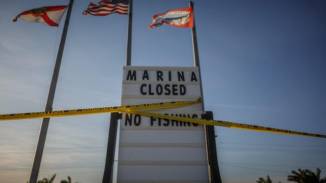 Signage shows the marina and campground is currently closed on the shore of Lake Okeechobee in Pahokee on April 22.
