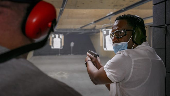 Patrick Dias, a certified firearms instructor, works with a handful of students at a West Palm Beach range on Wednesday, May 6, 2020. Florida life continues as new cases of COVID-19 are reported daily in Palm Beach County according to the Florida Department of Health, Division of Disease Control and Health Protection data.