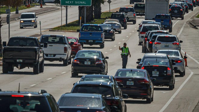 Hundreds of vehicles queued up Tuesday on Southern Boulevard to enter the Hospitality Helping Hands Grocery Pickup.