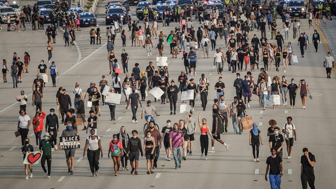 Protesters shut down north and southbound I-95 in central Palm Beach County at the exits for West Palm Beach, Fla., on Sunday, May 31, 2020.