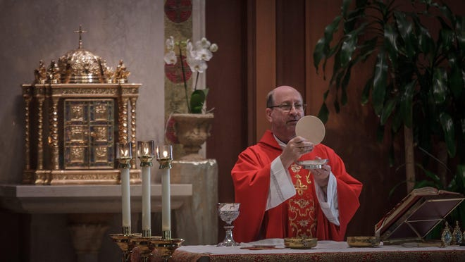 Parishioners met for Sunday's Mass with Very Rev. Thomas Barrett at The Cathedral of St. Ignatious of Loyola in Palm Beach Gardens, on Sunday, May 31, 2020. Today's morning services were the first in weeks at the church.