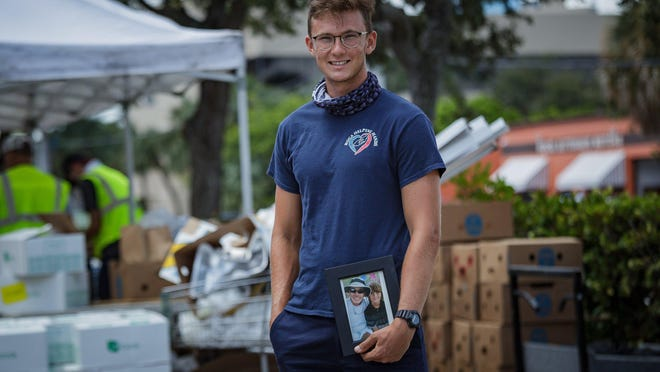 Luke Lynch, Boca Raton, volunteers at Boca Helping Hands on Friday, June 12, 2020, in Boca Raton, Fla. Luke continues his late father Jim Lynch's legacy of volunteer work at the food distribution center.