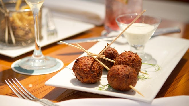 The blue-crab hush puppies appetizer at PB Catch is just $5 during the 5-6:30 p.m. happy hour.