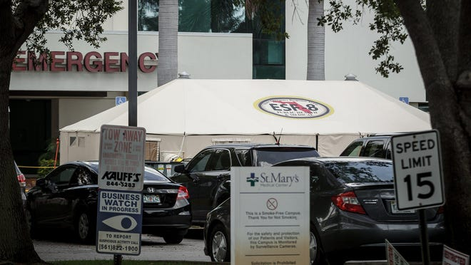 Pre-admission tents are back up Wednesday at St. Mary's Medical Center in West Palm Beach after having been removed while the coronavirus relented. But as the pace of the spread of the disease has quickened in recent weeks, the hospital is once again checking patients before they enter.