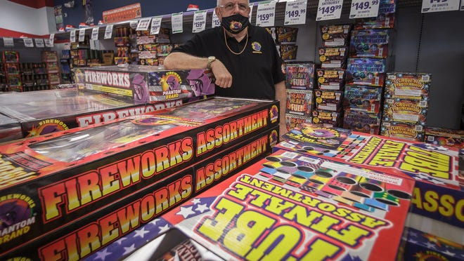 Ira Schwartz, regional manager for Phantom Fireworks, in a portrait at the Forest Hill Boulevard store with some of this year's firework offerings in Palm Springs, Fla., on Monday, June 29, 2020.