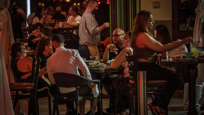 Patrons fill Rocco's Tacos in on Clematis Street in downtown West Palm Beach on June 9 after Gov. Ron DeSantis has eased restrictions on businesses, particularly restaurants.