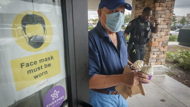 Sandy Goldfarb of Boynton Beach leaves with ice cream at a Carvel in Delray Beach, where he meets with a group of friends weekly. A stranger bought the group ice cream, Goldfarb said.