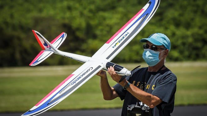 A pilot makes final checks of his aircraft at West Delray Regional Park in unincorporated Palm Beach County on Sunday, July 19, 2020. A handful of pilots flew the propeller and jet-propelled model airplanes at the park under mid-afternoon sunshine. Temperatures are expected to be in upper 80s with a chance scattered thunderstorms through the week according to wunderground.com.