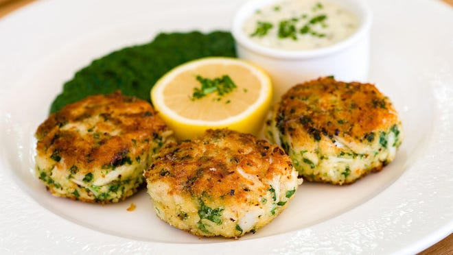 Jumbo-lump crab cakes served with creamed spinach is a Swifty's specialty.
