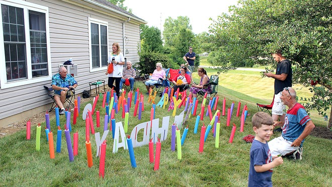 "Four generations of her family celebrated Lorine Austen's 94th birthday with a ""window party"" outside her room at Lutheran Village on July 7."