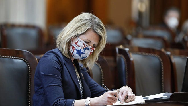 State Rep. Allison Russo (D-Upper Arlington) wears a mask during an Ohio House session last month.