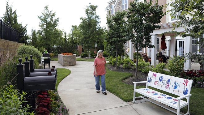 Jane Vanover walks along the destination stations outside of Senior Star Dublin Retirement Village. The outdoor area helps residents' mood and improves cognitive abilities, especially during the pandemic.