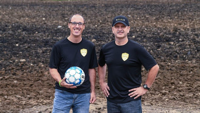 Bob Ritchie, travel director, and Brian Simeone, president, of the Alliance Community Soccer Club, stand in a field on West Ely St. where beginning next fall athletes will be playing. The first phase of the project calls for nine fields on the north side of the road.