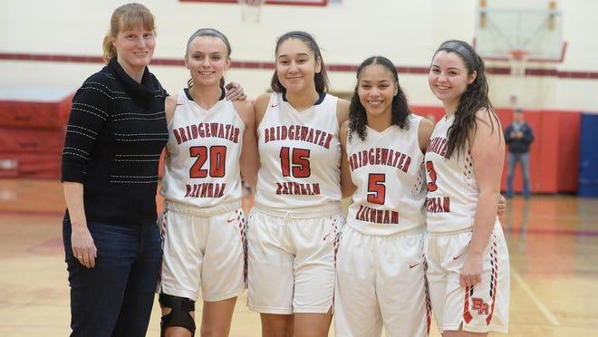 From left, Bridgewater-Raynham girls varsity basketball team head coach Cheryl Seavey, and her seniors  Shannon Lynch, Cai-Lee Lopes, Kiye Collins, and Brooke Reagan,Tuesday, Feb. 13, 2018.
