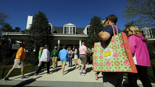 Patrons visit the new golf shop at Augusta National Golf Club, Sunday, April 1, 2018, in Augusta, Georgia.