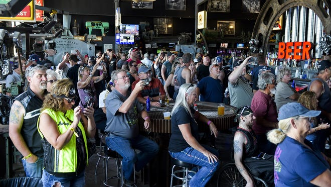 People watch a concert at the Full Throttle Saloon during the 80th Annual Sturgis Motorcycle Rally in Sturgis, South Dakota on August 9, 2020. While the rally usually attracts around 500,000 people, officials estimate that more than 250,000 people may have attended to this year's festival despite the coronavirus pandemic.