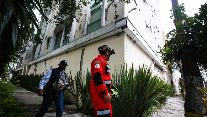 An urban search and rescue rescuer looks at a damage bulding since the 2017 earthquake on June 23, 2020 in Mexico City, Mexico. According to the National Seismological Service a 7.5 magnitude earthquake was registered on Tuesday in Mexico City and in various areas of the country.