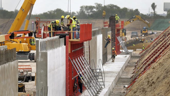 Border wall construction is going strong in the town of Hidalgo, near McAllen, Texas, on May 14, 2020.