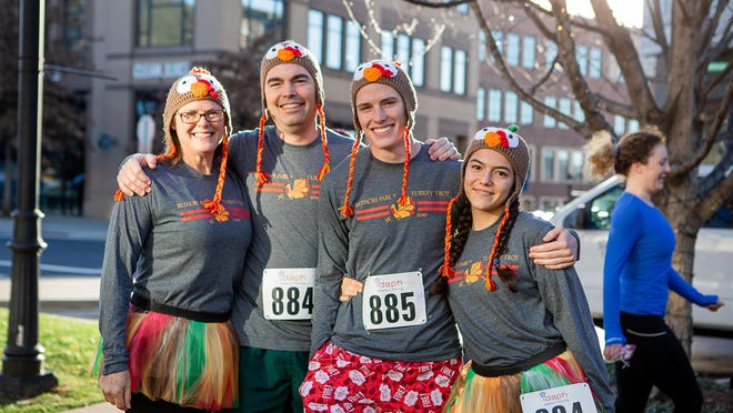 A family poses at last year's South Asheville Turkey Trot at Biltmore Park Town Square.