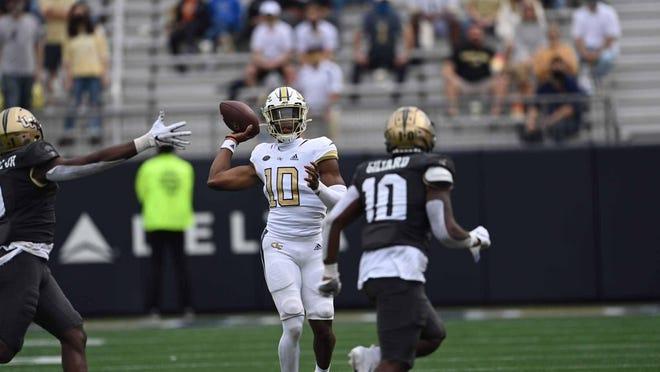 Georgia Tech freshman quarterback Jeff Sims (10) passes against Central Florida on Sept. 19 at Bobby Dodd Stadium in Atlanta.