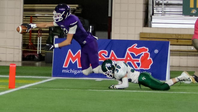 Nick Edington of Pickford reaches for the end zone while a Portland St. Patrick player pursues during the 2019 8-Player Division 1 state championship game at the Superior Dome. Edington was among a large group of area players selected to participate in the 2020 U.P. Football All-Star Game at the Superior Dome this summer. That game has been canceled due to COVID-19 concerns.