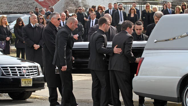 Pallbearers carry the casket of Joseph Rodriguez, 28, on Wednesday at St. Elizabeth R.C. Church in Linden.