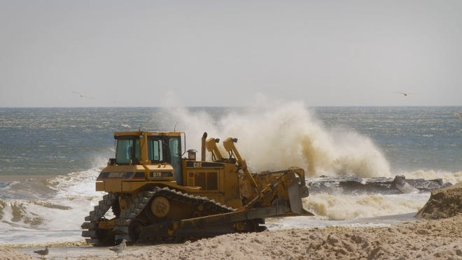 A bulldozer moves the pumped sand around to where its needed to make a level beach. Beach replenishment continues in Belmar with work now being done near the southern border of the town on April 05, 2014  Peter Ackerman/Staff Photographer