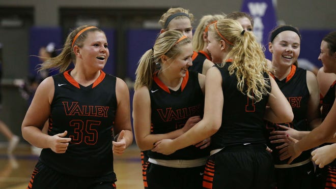 The No. 2 Valley Tigers celebrate their win against the No. 1 Waukee Warriors on Tuesday, Jan. 6, 2014 in the Waukee Fieldhouse. The Tigers beats the Warriors 72-66.