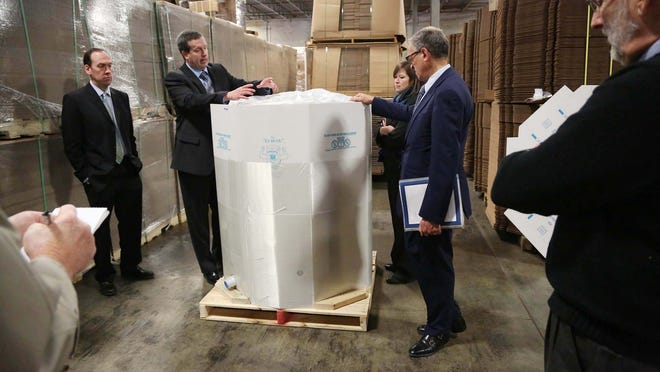 Kevin Stuart, director of international sales and marketing for Paper Systems Inc., leads a tour of the liquid bulk packaging company's production plant and warehouse area for Fred Hochberg, chairman and president of the Export-Import Bank of the United States and other officials and media on Wednesday in Des Moines. Paper Systems works with the Ex-Im bank to sell products overseas.